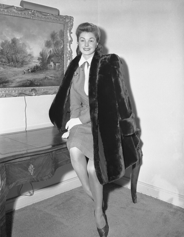 . Esther Williams, actress, at the plastic exhibit wears a fur coat in Los Angeles Jan. 31, 1945, that has been Calva processed. This process covers the modifications of the physical structure of the fibre of the pelt to imitate well known high priced furs. One of the most spectacular accomplishments of the Calva process is the transformation that it brings about on shorn sheepskins or shearlings to imitate beaver, seal, nutria, etc. (AP Photo)