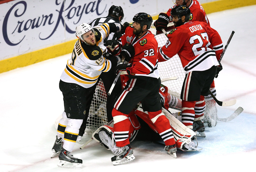 . CHICAGO, IL - JUNE 22:  Tyler Seguin #19 of the Boston Bruins and Michal Rozsival #32 of the Chicago Blackhawks push each other in front of the net in Game Five of the 2013 NHL Stanley Cup Final at United Center on June 22, 2013 in Chicago, Illinois.  (Photo by Jonathan Daniel/Getty Images)