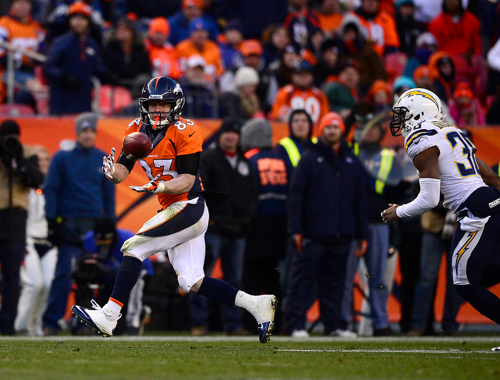 . Denver Broncos wide receiver Wes Welker (83) makes a catch for a first down in the third quarter. The Denver Broncos take on the San Diego Chargers at Sports Authority Field at Mile High in Denver on January 12, 2014. (Photo by AAron Ontiveroz/The Denver Post)