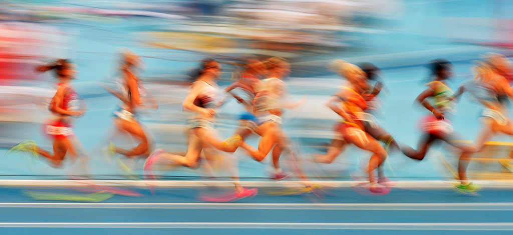 . Athletes compete in a women\'s 1500-meter heat at the World Athletics Championships in the Luzhniki stadium in Moscow, Russia, Sunday, Aug. 11, 2013. (AP Photo/Martin Meissner)