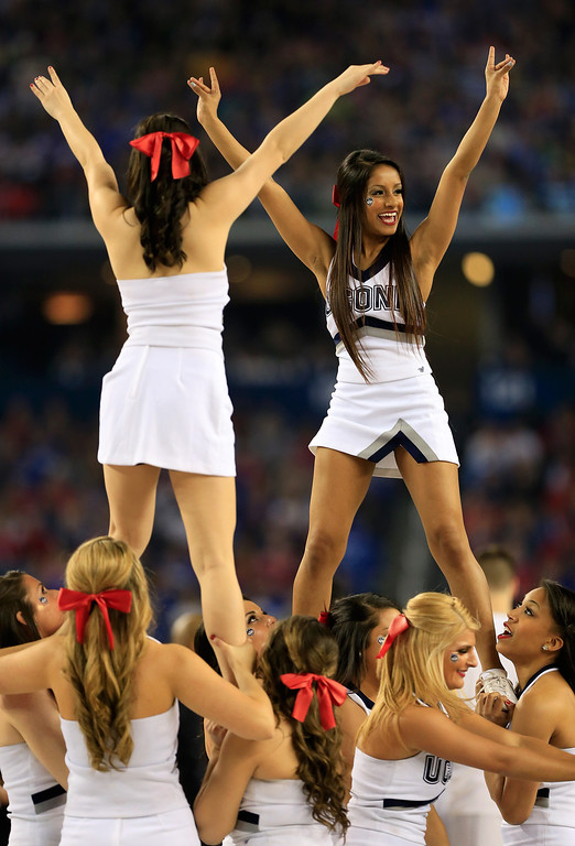 . ARLINGTON, TX - APRIL 07: Connecticut Huskies cheerleaders perform during the NCAA Men\'s Final Four Championship against the Kentucky Wildcats at AT&T Stadium on April 7, 2014 in Arlington, Texas.  (Photo by Jamie Squire/Getty Images)