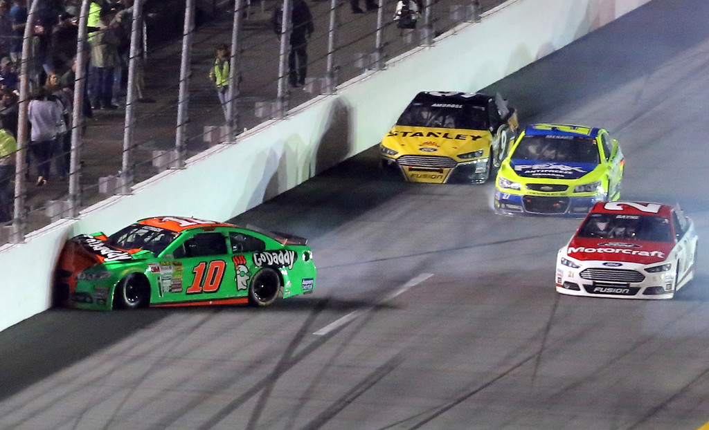 . Danica Patrick (10) hits the wall during the NASCAR Daytona 500 Sprint Cup series auto race at Daytona International Speedway in Daytona Beach, Fla., Sunday, Feb. 23, 2014. (AP Photo/David Graham)