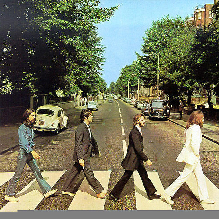 ". January 2003:  The original copy of the Beatles Abbey Road album cover shows Paul McCartney, third in line, holding a cigarette. United States poster companies have airbrushed this image to remove the cigarette from McCartney\'s hand. This change was made without the permission of either McCartney or Apple Records, which owns the rights to the image. ""We have never agreed to anything like this,\"" said an Apple spokesman. \""It seems these poster companies got a little carried away. They shouldn\'t have done what they have, but there isn\'t much we can do about it now.\""  SOURCE: http://www.cs.dartmouth.edu/farid/research/digitaltampering/"