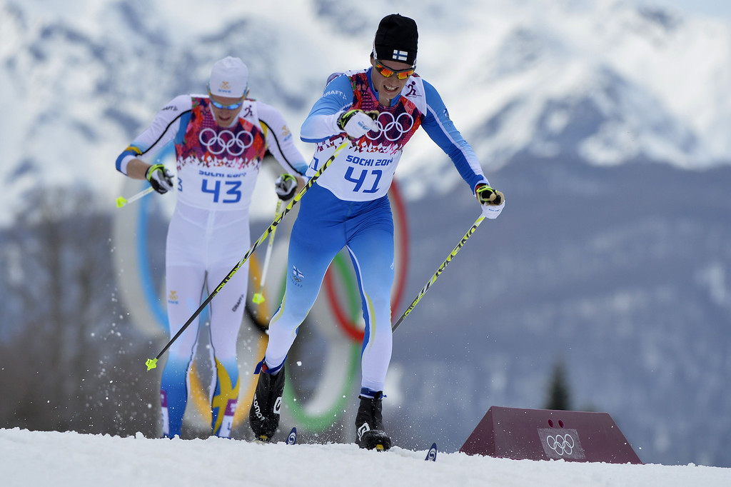 . Sweden\'s Daniel Richardsson (42) and Finland\'s Matti Heikkinen (41) compete in the Men\'s Cross-Country Skiing 15km Classic at the Laura Cross-Country Ski and Biathlon Center during the Sochi Winter Olympics on February 14, 2014 in Rosa Khutor near Sochi. AFP PHOTO / ODD ANDERSEN/AFP/Getty Images