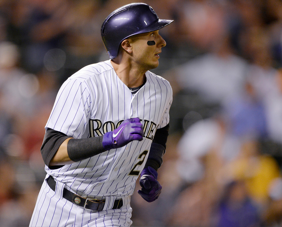 . Colorado Rockies shortstop Troy Tulowitzki (2) hits a home run in the 9th inning off of Arizona Diamondbacks relief pitcher Addison Reed (43) in the 9th inning June 3, 2014 at Coors Field. The Arizona Diamondbacks defeated the Colorado Rockies 4-2. (Photo by John Leyba/The Denver Post)