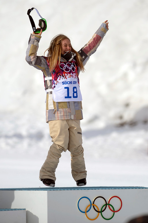 . Gold medalist Jamie Anderson, of the United States, celebrates on the podium after winning the women\'s snowboard slopestyle final. Sochi 2014 Winter Olympics at the Rosa Khutor Etreme Park on Sunday, February 9, 2014. (Photo by AAron Ontiveroz/The Denver Post)