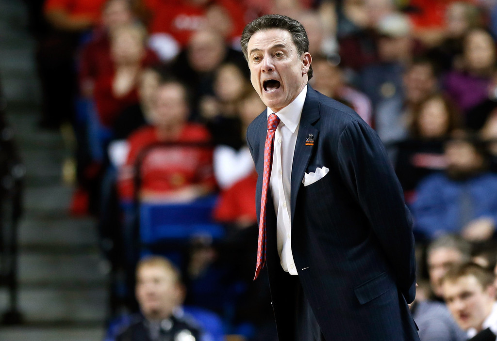 . LEXINGTON, KY - MARCH 23:  Head coach Rick Pitino of the Louisville Cardinals reacts on the sideline in the first half against the Colorado State Rams during the third round of the 2013 NCAA Men\'s Basketball Tournament at Rupp Arena on March 23, 2013 in Lexington, Kentucky.  (Photo by Kevin C. Cox/Getty Images)