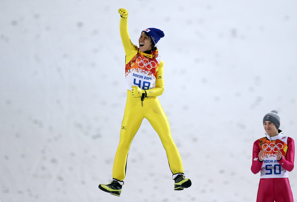 . Silver medalist Noriaki Kasai (L) of Japan celebrates next to gold medalist Kamil Stoch of Poland (R) during the flower ceremony for Men\'s Large Hill Individual Final Round in RusSki Gorki Jumping Center at the Sochi 2014 Olympic Games, Krasnaya Polyana, Russia, 15 February 2014.  EPA/KAY NIETFELD