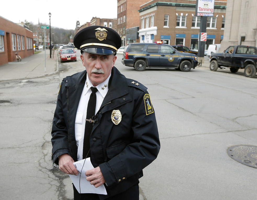 . Chief Joseph Malone of the Herkimer Police Department briefs the media on the search for a suspect in two shootings that killed four and injured at least two on Wednesday, March 13, 2013, in Herkimer, N.Y.  (AP Photo/Mike Groll)