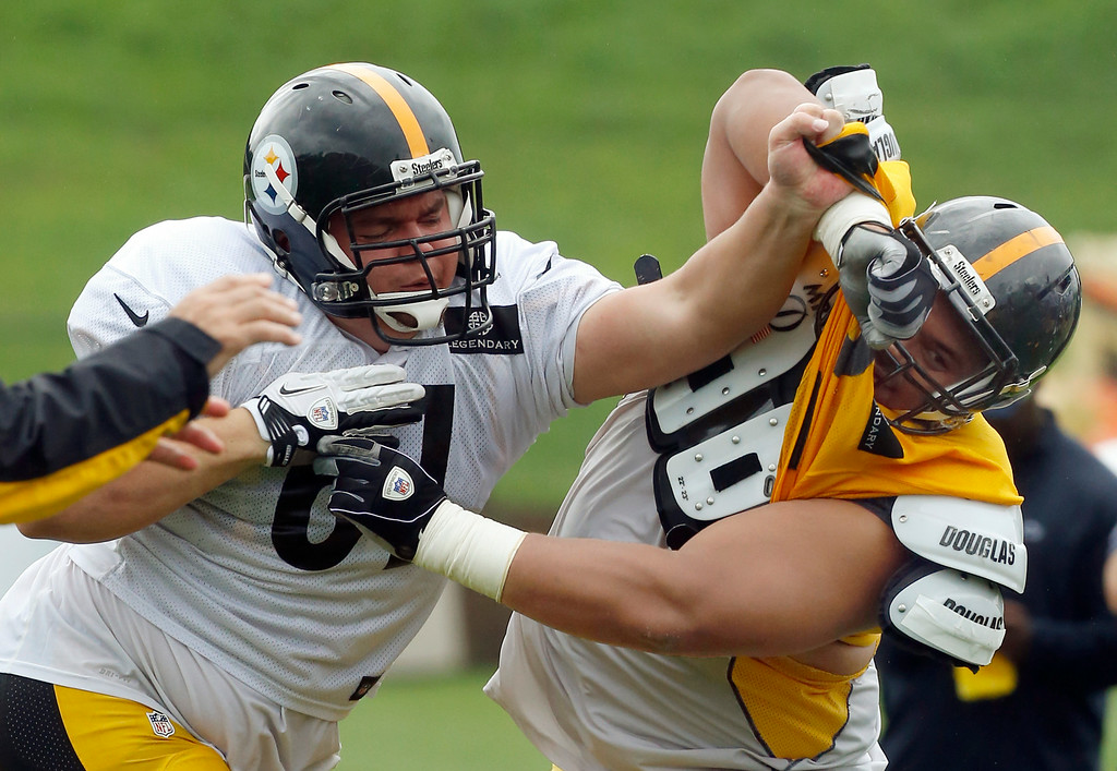 . Pittsburgh Steelers center Chris Elkins, left, works on defensive tackle Hebron Fangupo (92) during a blocking drill in practice at NFL football training camp in Latrobe, Pa., on Monday, July 28, 2014 . (AP Photo/Keith Srakocic)