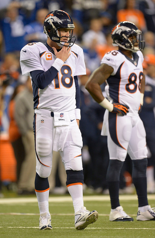 . Denver Broncos quarterback Peyton Manning (18) licks his fingers as he heads to the huddle against the Indianapolis Colts October 20, 2013 at Lucas Oil Field. Photo by John Leyba/The Denver Post)