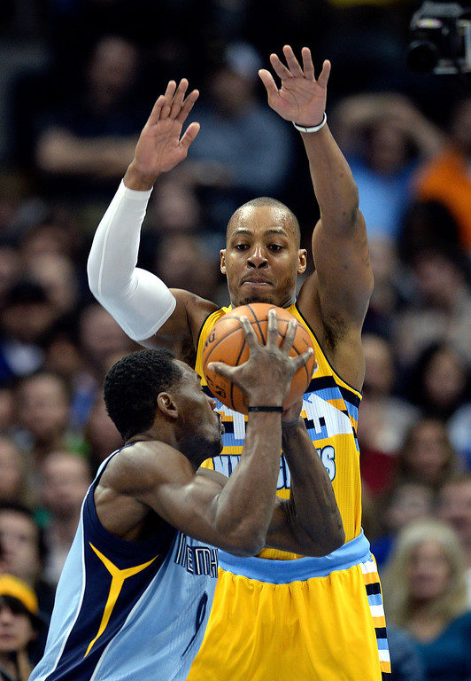 . DENVER, CO. - JANUARY 03:  Nugget\'s guard Randy Foye (4) tried to prevent a shot from Grizzlies\' guard Tony Allen (9) in the first half. The Denver Nuggets hosted the Memphis Grizzlies at the Pepsi Center Friday night, January 3, 2014. Photo By Karl Gehring/The Denver Post