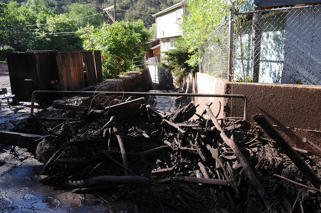 . Flooding that severely damaged numerous homes and businesses along Canon Ave., was in the cleanup stage Tuesday morning.  (Photo By Steve Nehf / The Denver Post)