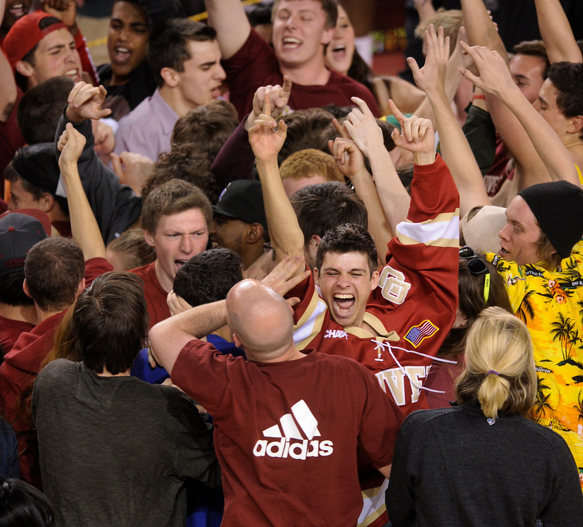 . DENVER, CO. - MARCH 2: Pioneers fans stormed the court following the win Saturday. The University of Denver men\'s basketball team defeated New Mexico State 66-60 Saturday evening, March 2, 2013 at Magness Arena. (Photo By Karl Gehring/The Denver Post)