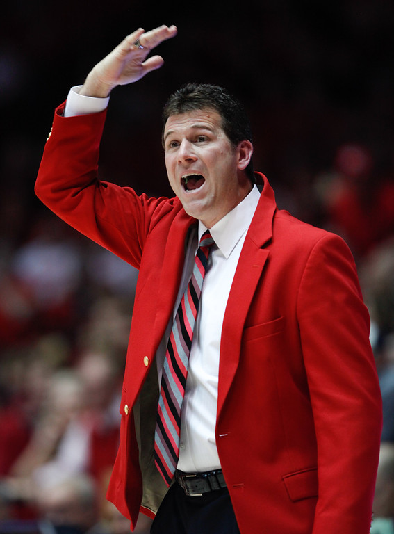 . New Mexico coach Steve Alford signals to his players during the first half of their NCAA college basketball game against Wyoming in Albuquerque, N.M., Saturday, March 2, 2013. (AP Photo/ Craig Fritz)