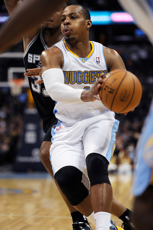 . Randy Foye #4 of the Denver Nuggets passes the ball during the fourth quarter of an NBA game against San Antonio Spurs at the Pepsi Center on November 5, 2013, in Denver, Colorado. The Nuggets fell to the Spurs 102-94 and are now 0-3. (Photo by Daniel Petty/The Denver Post)
