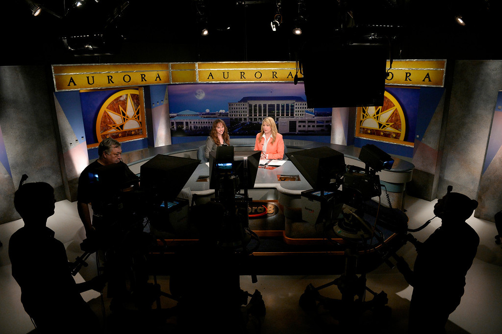 . AURORA, CO. - FEBRUARY 18: (l-r) Anchors Amanda Turner and Wendy Brockman sit at the desk during the taping of Aurora News Weekly in Aurora, CO February 18, 2014. The 30 minute news show is part of Aurora 8\'s public access programming. (Photo By Craig F. Walker / The Denver Post)