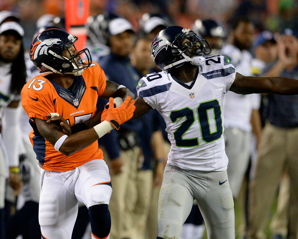 . Seattle Seahawks cornerback Jeremy Lane (20) ws called for defensive interference on Denver Broncos wide receiver Nathan Palmer (13) during the third quarter August 7, 2014 at Sports Authority Field at Mile High Stadium.  (Photo by John Leyba/The Denver Post)