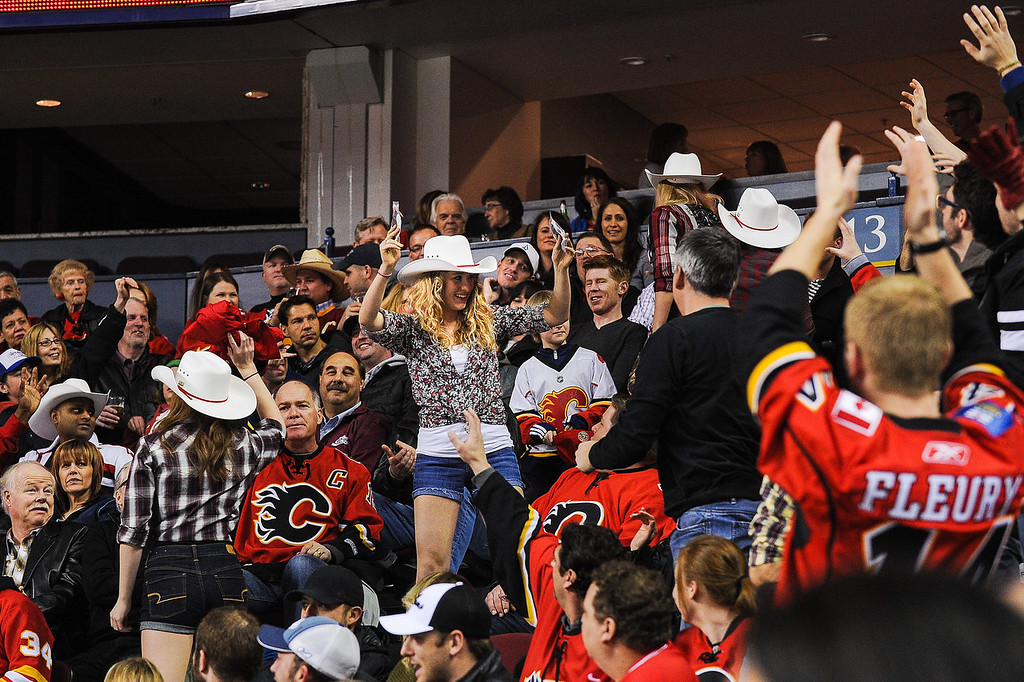 . Girls dressed in western clothes to celebrate Western Night rally the crowd between play during an NHL game between the Calgary Flames and the Minnesota Wild at Scotiabank Saddledome on February 1, 2014 in Calgary, Alberta, Canada. (Photo by Derek Leung/Getty Images)
