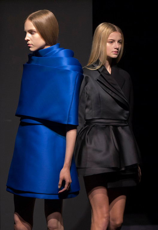 . Models wear creations as part of the Dice Kayek Fall Winter 2014-15 Haute Couture fashion collection, presented in Paris, Thursday, July 10, 2014. (AP Photo/Jacques Brinon)