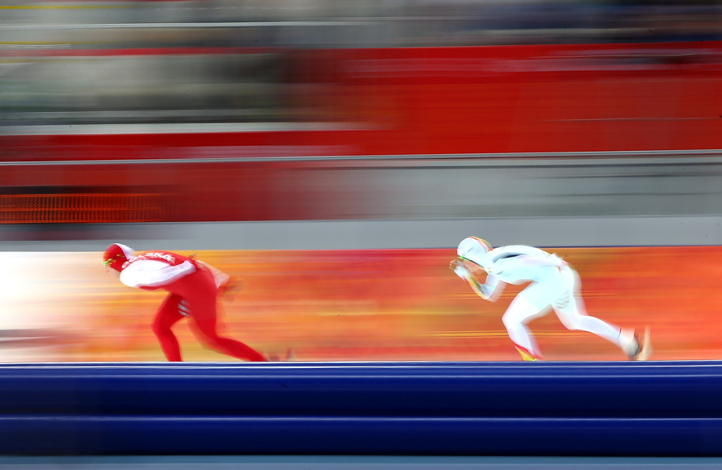 . Natalia Czerwonka of Poland (L) and Jelena Peeters of Belgium compete during the Women\'s 3000m Speed Skating event during day 2 of the Sochi 2014 Winter Olympics at Adler Arena Skating Center on February 9, 2014 in Sochi, Russia.  (Photo by Streeter Lecka/Getty Images)
