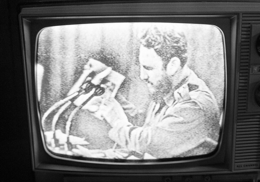 . Cuban premier Fidel Castro holds a magazine, during a television speech in Havana Sunday, Oct. 16, 1967 which contains pictures from Bolivia of his former aide, Ernesto Che Guevara who was killed recently in the Bolivian Jungles. (AP Photo)