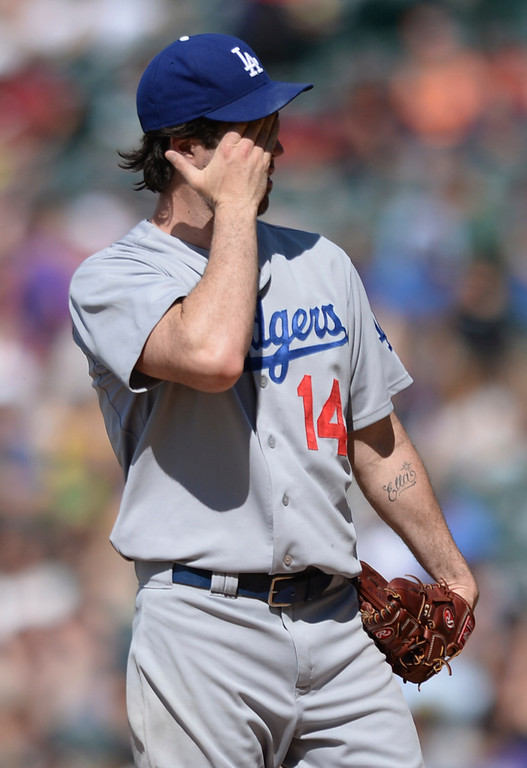 . DENVER, CO - JULY 5:  Dodgers starting pother Dan Haren wiped his brow after he gave up a triple to Charlie Culberson in the sixth inning. The Colorado Rockies defeated the Los Angeles Dodgers 8-7 at Coors Field Saturday afternoon, July 5, 2014.  Photo by Karl Gehring/The Denver Post