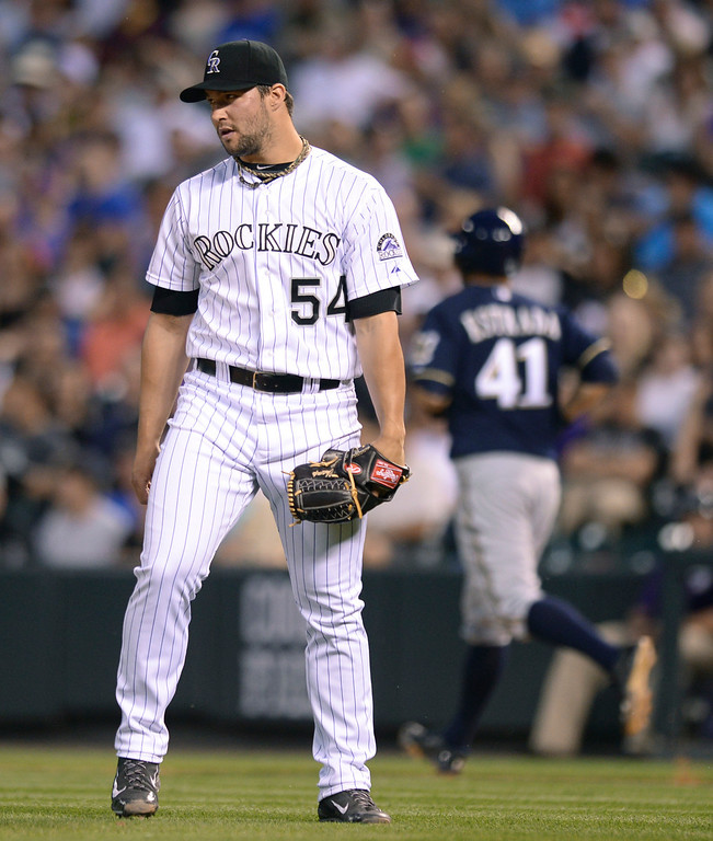 . DENVER, CO - JUNE 20: Rockies reliever Tommy Kahnle walked Milwaukee pitcher Marco Estrada in the fifth inning. The Colorado Rockies hosted the Milwaukee Brewers at Coors Field Friday night, June 20, 2014. Photo by Karl Gehring/The Denver Post