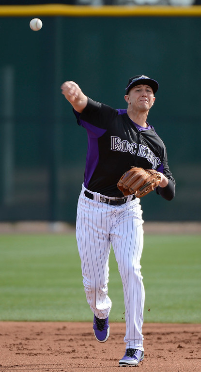 . SCOTTSDALE, AZ. - FEBRUARY 19: Colorado Rockies Troy Tuloitzki (2) makes a throw over to first during Spring Training February 19, 2013 in Scottsdale. (Photo By John Leyba/The Denver Post)