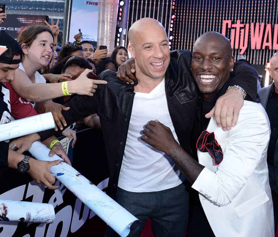 """. Actor Vin Diesel, left, and actor Tyrese Gibson embrace at the LA Premiere of the \""""Fast & Furious 6\"""" at the Gibson Amphitheatre on Tuesday, May 21, 2013 in Universal City, Calif. (Photo by Dan Steinberg/Invision/AP)"""