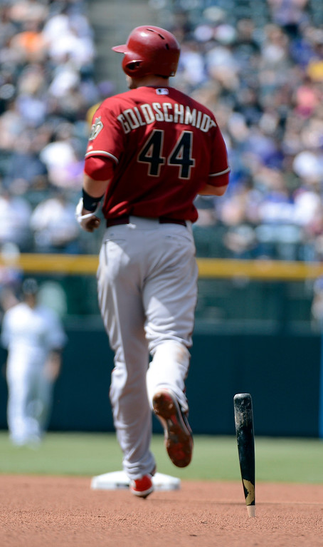 . DENVER, CO. - APRIL 21: Paul Goldschmidt (44) of the Arizona Diamondbacks runs by a broken bat that stuck in the dirt during the first inning against the Colorado Rockies April 21, 2013 at Coors Field. (Photo By John Leyba/The Denver Post)