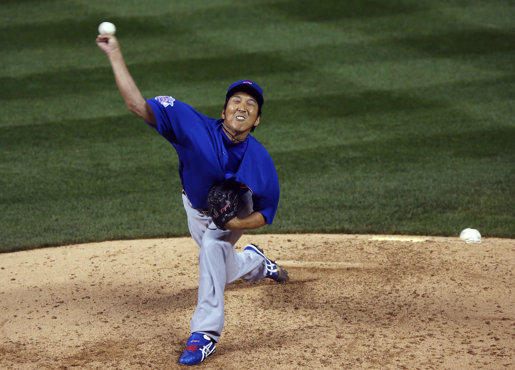 . Making his first appearance since Tommy John surgery in June 2013, Chicago Cubs relief pitcher Kyuji Fujikawa works against the Colorado Rockies in the sixth inning of a baseball game in Denver on Wednesday, Aug. 6, 2014. (AP Photo/David Zalubowski)