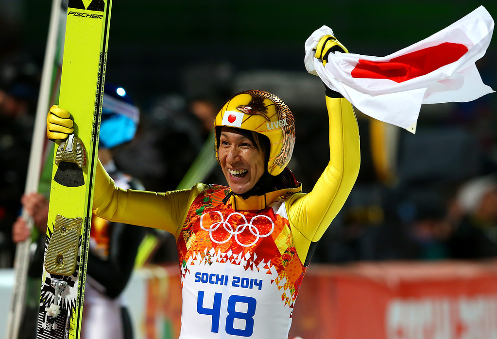 . SOCHI, RUSSIA - FEBRUARY 15:  Silver medalist Noriaki Kasai of Japan celebrates with the Japanese national flag after the Men\'s Large Hill Individual Final Round on day 8 of the Sochi 2014 Winter Olympics at the RusSki Gorki Ski Jumping Center on February 15, 2014 in Sochi, Russia.  (Photo by Alexander Hassenstein/Getty Images)