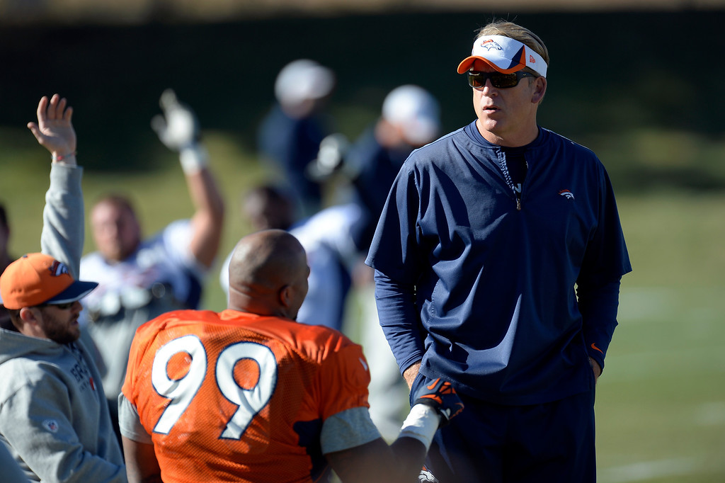 . Denver Broncos defensive coach/interim coach Jack Del Rio talks with Denver Broncos defensive tackle Kevin Vickerson (99) before practice November 20, 2013 at Dove Valley (Photo by John Leyba/The Denver Post)
