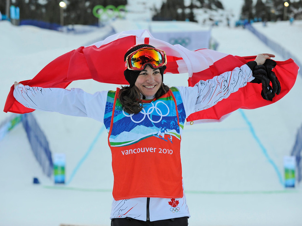 . Maelle Ricker of Canada celebrates winning the ladies snowboardcross final at the Vancouver 2010 Olympics in Vancouver, British Columbia, Tuesday, Feb. 16, 2010. (AP Photo/Mark J. Terrill)
