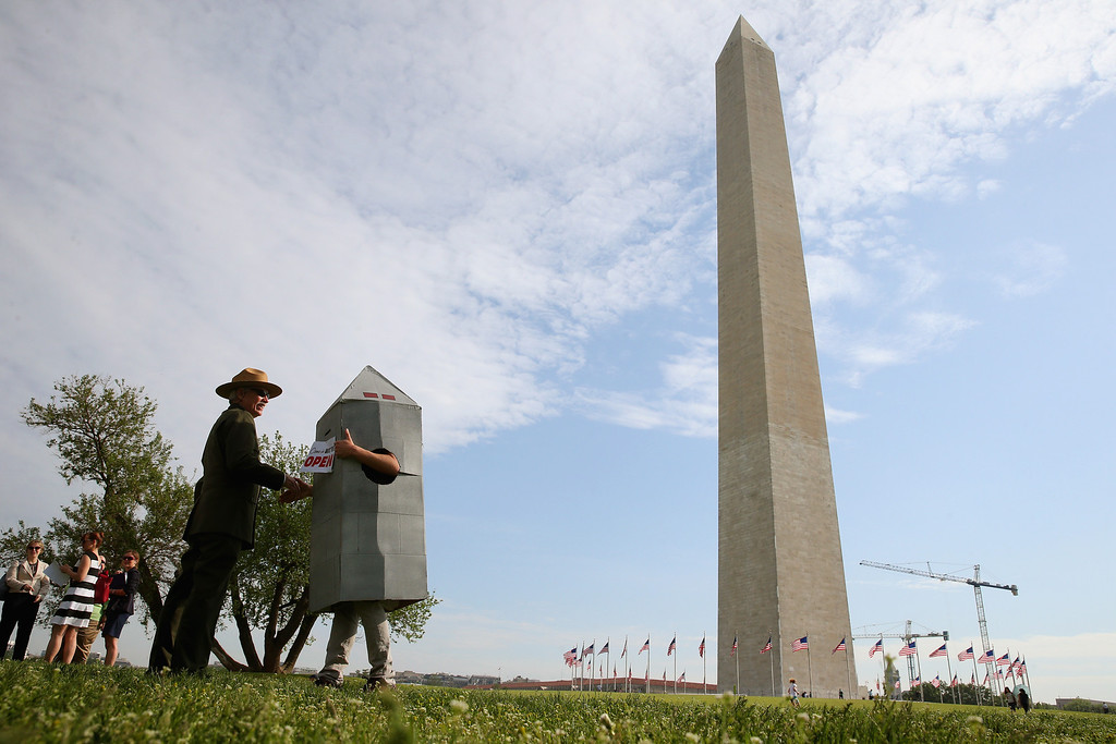 . National Park Service Director Johnathan Jarvis (L) greets Steven Avilla who is wearing a Washington monument costume on the grounds of the Washington Monument,  in Washington, DC.  (Photo by Mark Wilson/Getty Images)