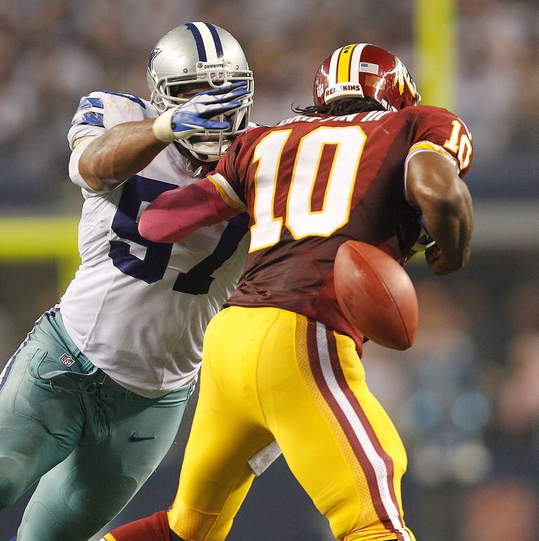 . Dallas Cowboys linebacker DeVonte Holloman knocks the ball from Washington Redskins quarterback Robert Griffin III at AT&T Stadium in Arlington, Texas, on Sunday, October 13, 2013. (Ron Jenkins/Fort Worth Star-Telegram/MCT)