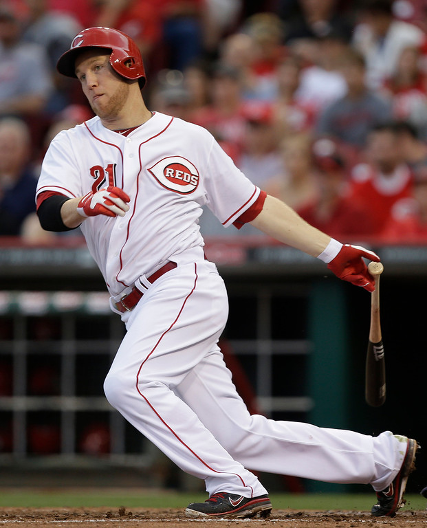 . Cincinnati Reds\' Todd Frazier hits a double off Colorado Rockies starting pitcher Juan Nicasio to drive in a run in the fourth inning of a baseball game, Tuesday, June 4, 2013, in Cincinnati. (AP Photo/Al Behrman)