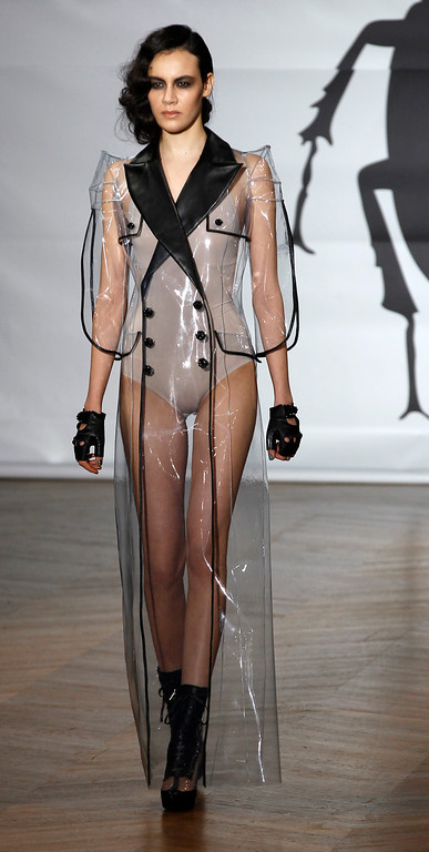 . A models wears a creations by Bulgarian designers Livia Stoianova and Yassen Samouilov for On Aura Tour Vu\'s Spring Summer 2013 Haute Couture fashion collection, presented in Paris, Wednesday, Jan.23, 2013. (AP Photo/Remy de la Mauviniere)