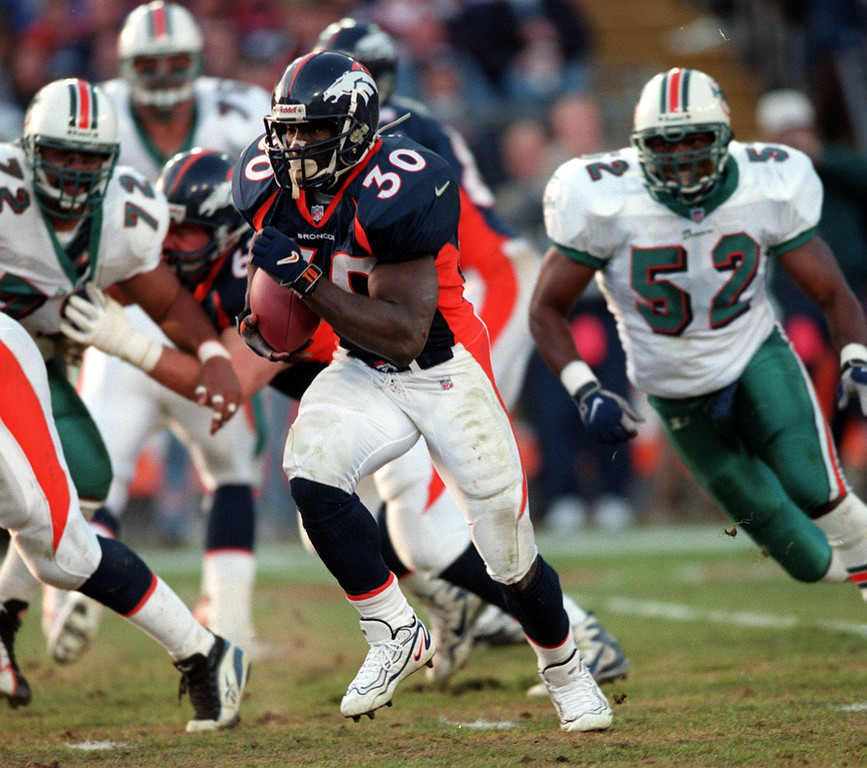 . Denver blew out Miami, out gaining them in rushing yards 250-14 and scoring touchdowns on their first three possessions. Denver won the AFC Divisional Playoff game 38-3.   Denver Broncos Terrell Davis runs for a big gain against  the Miami Dolphins during the second quarter of their AFC playoff  game at Mile High Stadium in Denver CO.  Photographer: KARL GEHRING/THE DENVER POST