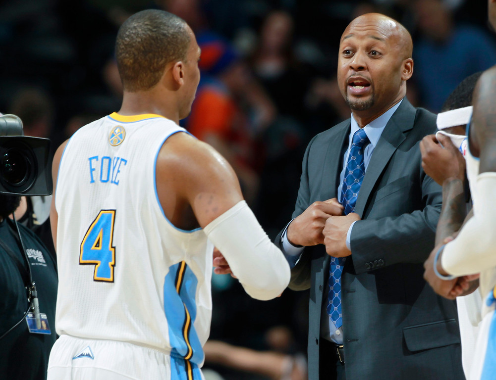 . Denver Nuggets head coach Brian Shaw, right, confers with guard Randy Foye late in the fourth quarter of the Nuggets\' 110-100 victory over the Milwaukee Bucks in an NBA basketball game in Denver on Wednesday, Feb. 5, 2014. (AP Photo/David Zalubowski)