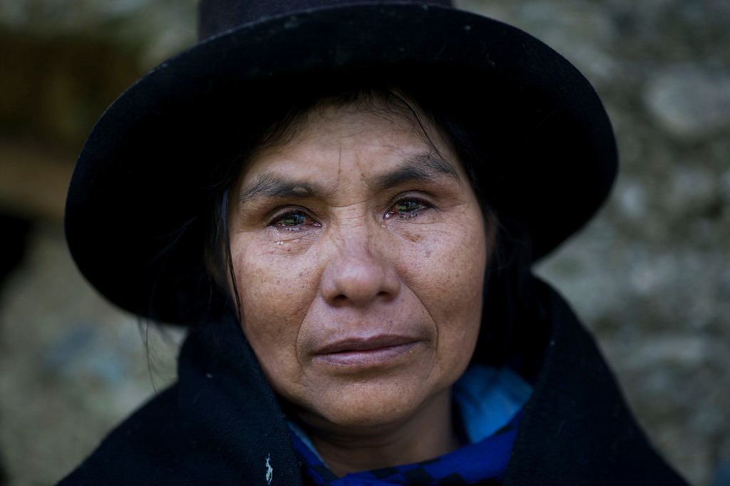 . Eudicia Urbano, 70, standing in front of her former home, near the spot where her husband Marcial Escalante died, weeps as she retells how he was tortured and killed by Shining Path rebels, in Chaca, Peru. The region endured some of the worst atrocities of Peru\'s 1980-2000 conflict, in which both Maoist-inspired insurgents and security forces committed grave human rights violations.   (AP Photo/Rodrigo Abd)