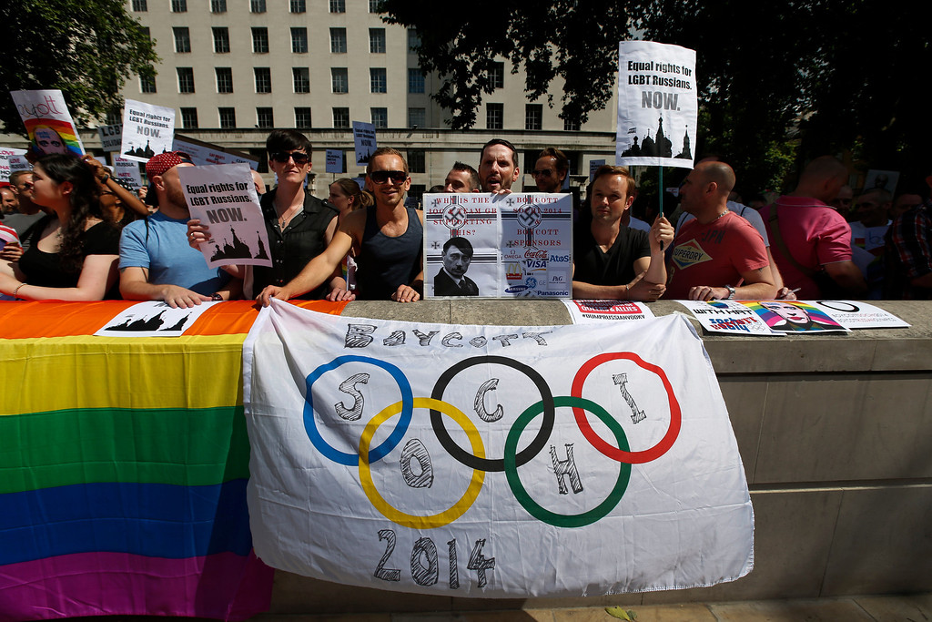 """. Activists participate at a protest against Russia\'s new law on gays, in central London, Saturday, Aug. 10, 2013.  Hundreds of protesters, called for the Winter 2014 Olympic Games to be taken away from Sochi, Russia, because of a new Russian law that bans \""""propaganda of nontraditional sexual relations\"""" and imposes fines on those holding gay pride rallies. (AP Photo/Lefteris Pitarakis)"""
