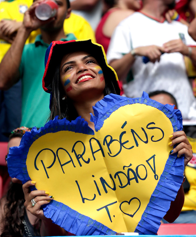 . A Colombian supporter holds a sign saying \'Congratulations Handsome\' before the group C World Cup soccer match between Colombia and Ivory Coast at the Estadio Nacional in Brasilia, Brazil, Thursday, June 19, 2014. (AP Photo/Marcio Jose Sanchez)