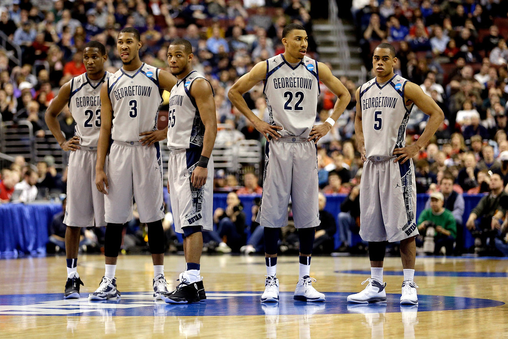 . PHILADELPHIA, PA - MARCH 22:  (L-R) Aaron Bowen #23, Mikael Hopkins #3, Jabril Trawick #55, Otto Porter Jr. #22 and Markel Starks #5 of the Georgetown Hoyas look on in the second half against the Florida Gulf Coast Eagles during the second round of the 2013 NCAA Men\'s Basketball Tournament at Wells Fargo Center on March 22, 2013 in Philadelphia, Pennsylvania.  (Photo by Rob Carr/Getty Images)