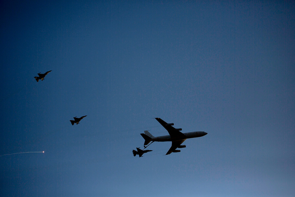 . An Israeli Air Force Boeing 707 refuels one F16 fighter jet as two others fly high during an aerobatic display at a graduation ceremony for new pilots in the Hatzerim air force base near the city of Beersheba, southern Israel, Thursday, Dec. 26, 2013. (AP Photo/Ariel Schalit)