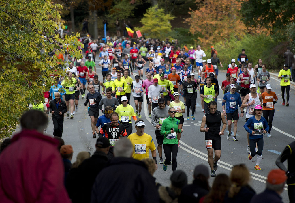 . Racers run through Central Park November 3, 2013 during the running of the New York City Marathon in New York.     DON EMMERT/AFP/Getty Images
