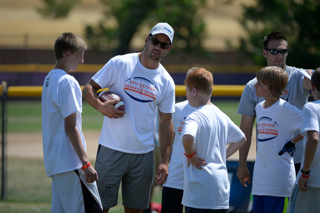 . Eric Decker gives the play to his team during his football camp at Littleton H.S. Demaryius Thomas and Eric Decker team up with ProCamps for their football camp held at Littleton High School July 11, 2013. (Photo By John Leyba/The Denver Post)