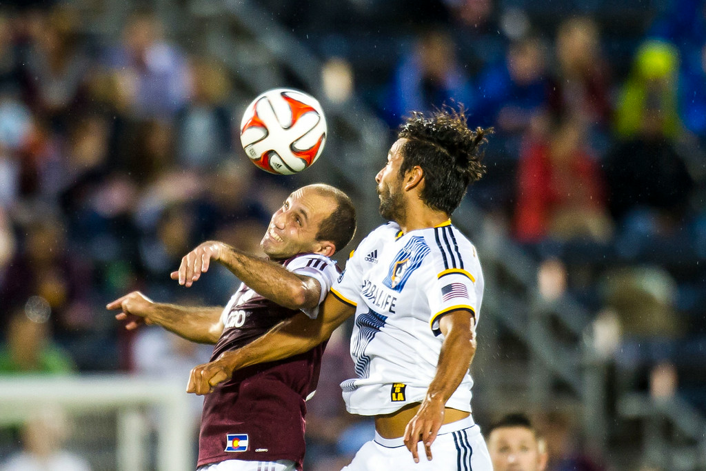 . COMMERCE CITY, CO - AUGUST 20:  Nick LaBrocca (2) of Colorado Rapids heads the ball over Baggio Husidic (6) of Los Angeles Galaxy during a Major League Soccer game at Dick\'s Sporting Goods Park on Wednesday, August 20, 2014 in Commerce City, Colorado.  Director Comey\'s visit to the Dick\'s Sporting Goods Park is part of his plan to visit all FBI Field Offices in his first year as director.  (Photo by Kent Nishimura/The Denver Post)