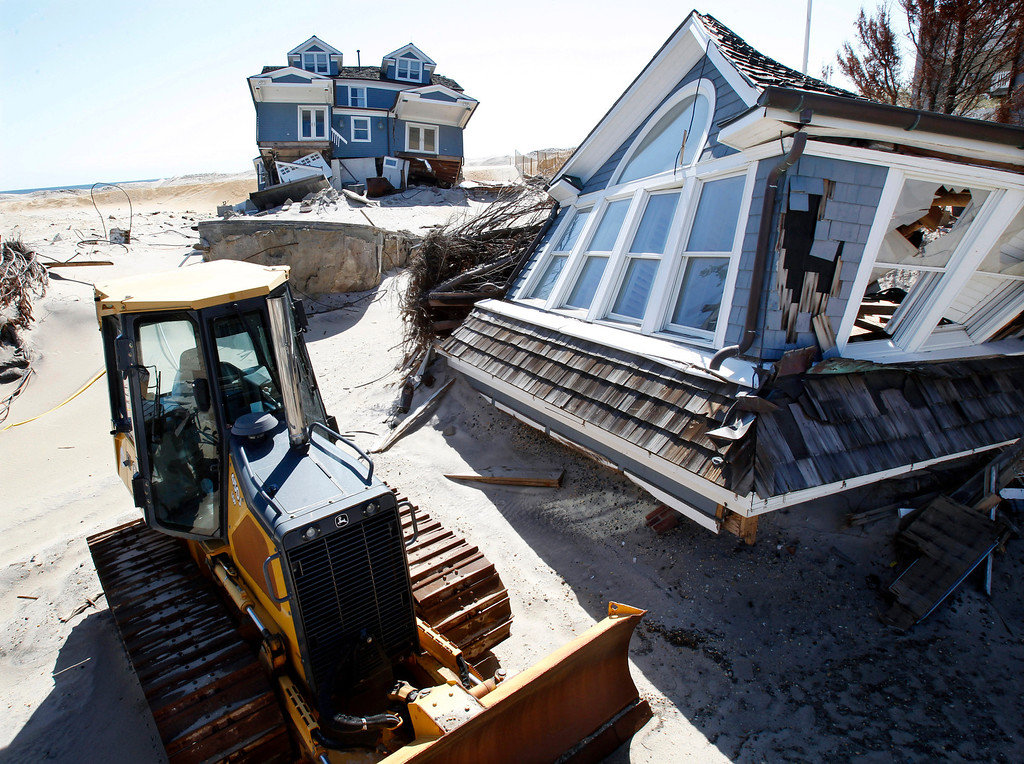 . Homes severely damaged last October by Superstorm Sandy, are seen along the beach Thursday, April 25, 2013, in Mantoloking, N.J. Six months after Sandy devastated the Jersey shore and New York City and pounded coastal areas of New England, the region is dealing with a slow and frustrating, yet often hopeful, recovery. (AP Photo/Mel Evans)